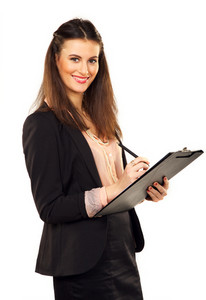 Portrait of a female professional smiling while writing on clipboard