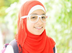 Portrait of a fresh beauty arabian school teenage girl with hijab