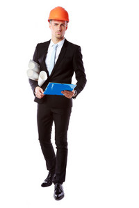 Portrait of a handsome businessman in helmet with blue folder over white background