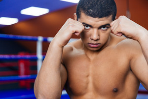Portrait of a handsome male boxer workout in gym