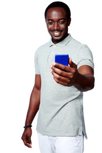 Portrait of a happy african man holding smartphone over white background