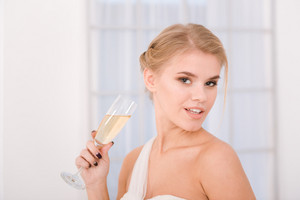 Portrait of a happy bride holding glass with champagne