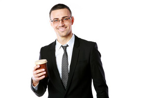 Portrait of a happy businessman in glasses holding cup of coffee over white background