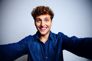 Portrait of a happy man over blue background