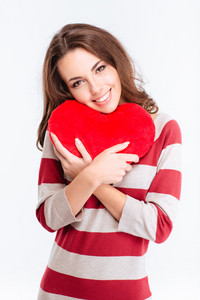 Portrait of a happy woman holding red heart isolated on a white background