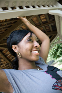 Portrait of a happy young Jamaican woman posing outdoors with a natural smile.