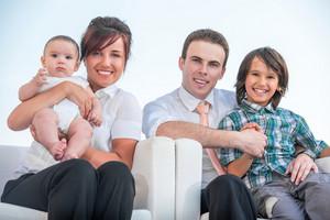 Portrait of a joyful family sitting outside