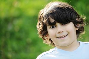 Portrait of a little happy boy outdoors