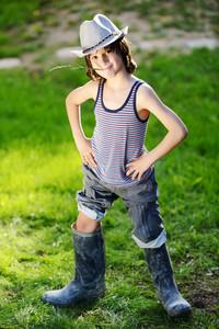 Portrait of a little kid outdoor in a summer meadow