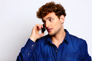 Portrait of a man in casual cloth talking on the phone