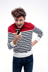 Portrait of a man shouting at smartphone over gray background