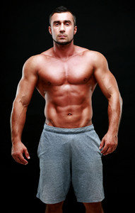Portrait of a muscular man isolated on a black background