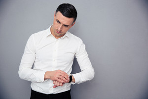Portrait of a pensive businessman with wristwatch