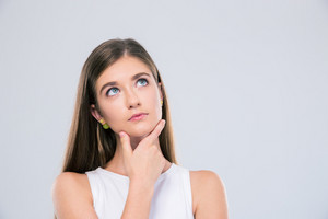 Portrait of a pensive female teenager looking up