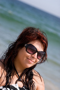Portrait of a pretty plus size model at the beach.
