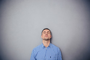 Portrait of a serious man with closed eyes