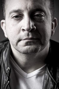 Portrait of a serious middle aged man.  Shallow depth of field.