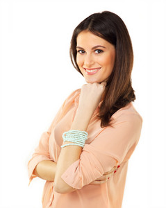 Portrait of a smiling lovely woman with pearl bracelet in a studio