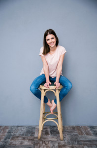 Portrait of a smiling woman sitting on the chair