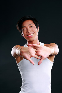 Portrait of a sports man stretching his arms
