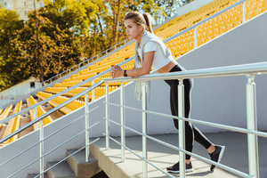 Portrait of a sports woman standing at outdoor stadium