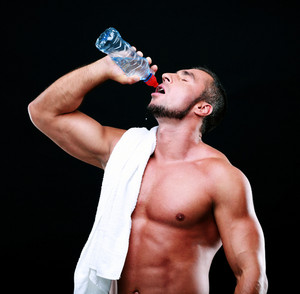 Portrait of a sportsman drinking water