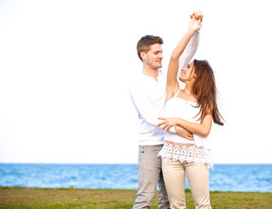 Portrait of a sweet couple having fun and dancing together outdoors