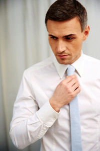 Portrait of a thoughtful businessman in white shirt