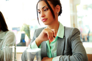 Portrait of a thoughtful businesswoman looking away in office