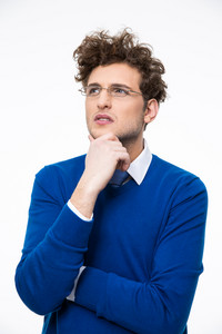 Portrait of a thoughtful young businessman in glasses