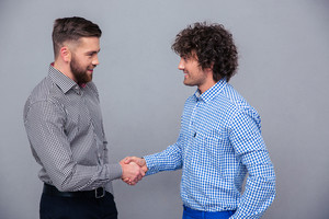 Portrait of a two casual men doing handshake