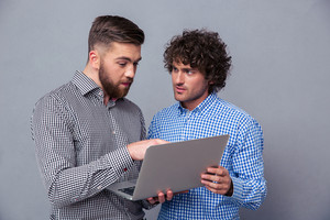 Portrait of a two men using laptop