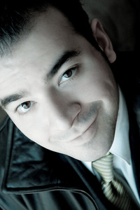 Portrait of a young business professional in his twenties with selective color.