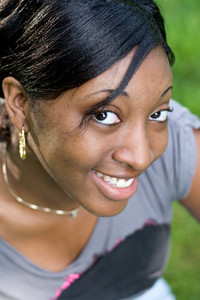 Portrait of a young Jamaican woman with a natural smile. Shallow depth of field.