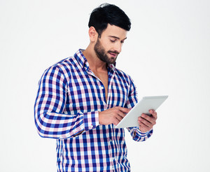 Portrait of a young man using tablet computer