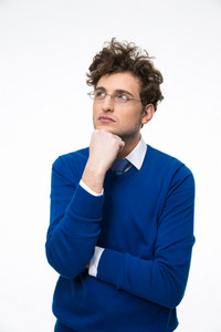 Portrait of a young pensive businessman in glasses looking up