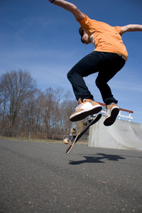 Portrait of a young skateboarder performing a trick at the skate park.