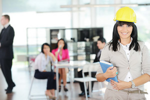 Portrait of a young successful female engineer with helmet