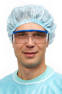 Portrait of a young surgeon in goggles
