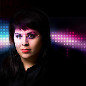 Portrait of a young woman under dramatic lighting with colorful abstract effects.