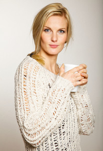 Portrait of an attractive woman holding a cup of coffee