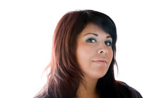 Portrait of an attractive young hispanic woman isolated over white.