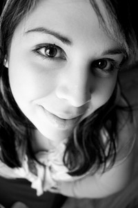 Portrait of an attractive young woman extremely close up in black and white.  Shallow depth of field.