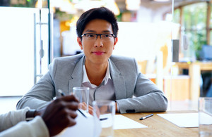 Portrait of asian man sitting at the table in office
