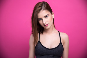 Portrait of attractive woman over pink background