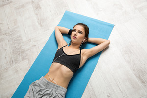 Portrait of attractive woman resting on the yoga mat