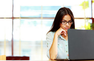 Portrait of busy businesswoman working at office