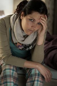 Portrait of Caucasian woman feeling sick flu illness