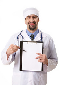 Portrait of confident doctor pointing at clipboard with prescriptions