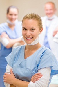 Portrait of dental team smiling female nurse with colleagues